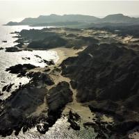 Black mountains of Ras Madrakha, Oman